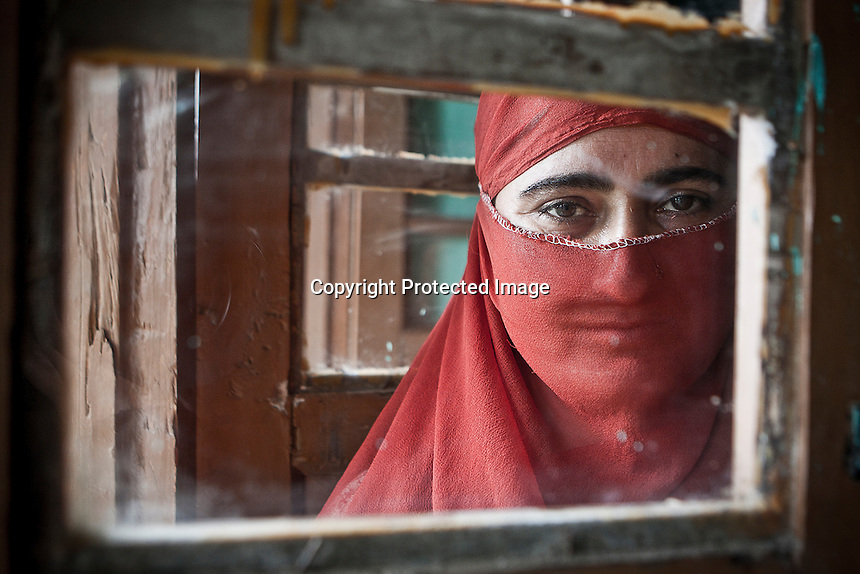 """Sahfiqa is not able to express in deep her feelings, but her hopeless words are full of sorrow: """"I don't expect my husband to get back. I don't hold any hope to see him again"""". Farooq, her loved one, joint to the militancy on 1996, at August 6th the militants picked him up from home and never came back. According with human rights APDP organization, Farooq most likely might be buried at one of the mass graves in Kashmir, where those bodies are unidentified and unmarked. Dolipora village, Kupwara district, Indian administrated Kashmir."""