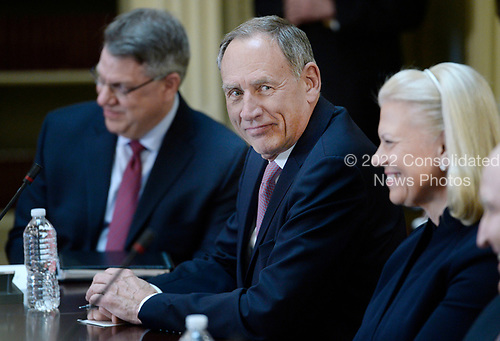 Toby Cosgrove, CEO, Cleveland Clinic looks on as United States President Donald Trump speaks during a strategic and policy discussion with CEOs in the State Department Library in the Eisenhower Executive Office Building (EEOB) in Washington, DC, April 11, 2017.<br /> Credit: Olivier Douliery / Pool via CNP