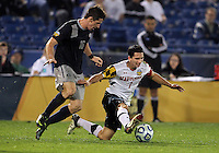 HOOVER, AL - DECEMBER 07, 2012:  Dan Metzger (7) of the University of Maryland pokes the ball away from Jimmy Nealis (16) of Georgetown University during an NCAA 2012 Men's College Cup semi-final match, at Regents Park, in Hoover , AL, on Friday, December 07, 2012. The game ended in a 4-4 tie, after overtime Georgetown won on penalty kicks.