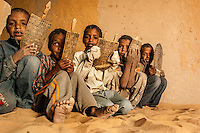 Arab Moor children study using tablets in the Sahara Desert village of Boujbeja. /Felix Features