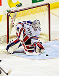 27 March 2007: New York Rangers goaltender Henrik Lundqvist of Sweden makes a save against the Montreal Canadiens at the Bell Centre in Montreal, Quebec, Canada...Mandatory Photo Credit: Ed Wolfstein Photo *** Editorial Sales through Icon Sports Media *** www.iconsportsmedia.com