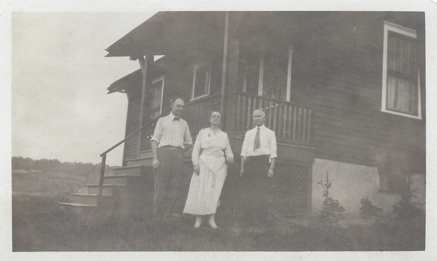 Title: John Voegtly with man and woman at Sarah's bungalow<br /> Type: Photo<br /> Cat #: 030b.(bottom)<br /> File Name: 30b_3of3.jpg<br /> Formats: original object
