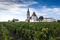 Village of Pomerol with vineyard, Chateau St Pierre and Church of St Jean in the Bordeaux wine region of France