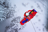 St Anton am Arlberg, Tyrol, Austria, January 2006. A helicopter of the OAMTC and ADAC lifts an injured person of the mountain. The Rescue medic will stay with the victim until landing. The Bergrettung Tirol mountain rescue teams have to respond to avalanches within 30 minutes if the victims are to have any chance of surviving. photo by Frits Meyst/Adventure4ever.com