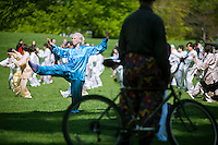 Participants perform their Tai Chi exercises during the World Tai Chi Day event in Central Park's East Meadow in New York on Saturday, April 28, 2012. Several hundred people representing Tai Chi schools in the New York area came together to simultaneously perform their exercises regardless of their experience or level. The event is repeated worldwide at exactly 10:00 AM in the participants' respective time zones creating a rolling energy of Tai Chi. (© Richard B. Levine)