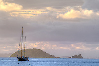 Dusk looking out towards Carvel Rock with a sailboat at anchor<br />