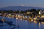 Sunset La Connor with Mount Baker with marinas and downtown along the Swinomish channel Washington State USA
