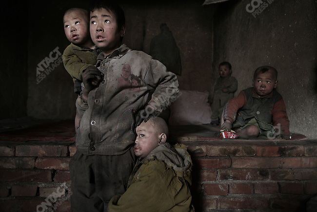 A family of five children emigrated to Inner Mongolia from Xiji County in nearby Ningxia Hui Autonomous Region to find work in the Heilonggui Industrial District. The eldest child is 9, the youngest is less than two. April 10, 2005.