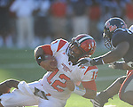 Jacksonville State quarterback Marques Ivory (12)  is tackled by Ole Miss safety Damien Jackson (1) at Vaught-Hemingway Stadium in Oxford, Miss. on Saturday, September 4, 2010. Jacksonville State won 49-48 in double overtime.