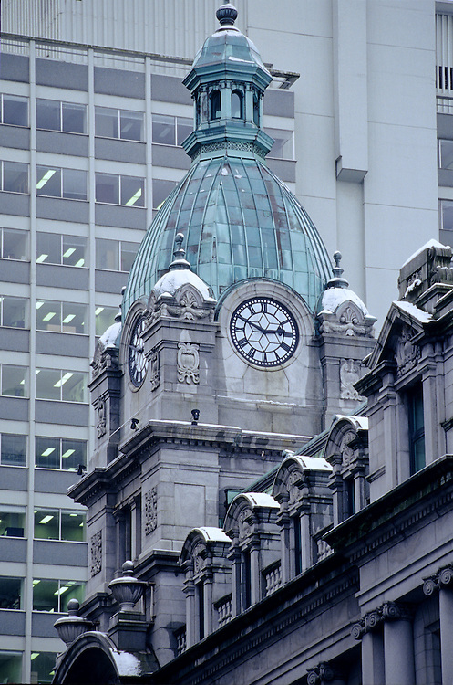 Sinclair Center (beaux arts) clock tower, dome, cupola and colonnade with snow, winter, downtown Vancouver, BC.