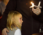 Six-year-old Halle Noel prays during a light prayer vigil at the Champion's Centre in Tacoma WA., for family members, friends and law enforcement officers for four Lakewood Police officers killed at a Lakewood coffee shop on Sunday, Nov. 29, 2009.  At about 8:00 a.m. Sunday morning, a gunman walked into the Forza Coffee shop and while the four police officers were having coffee before their shift started, he opened fire, killing all four law enforcement officers.  Halle  knew the police officers killed.Jim Bryant Photo. ©2010. ALL RIGHTS RESERVED.
