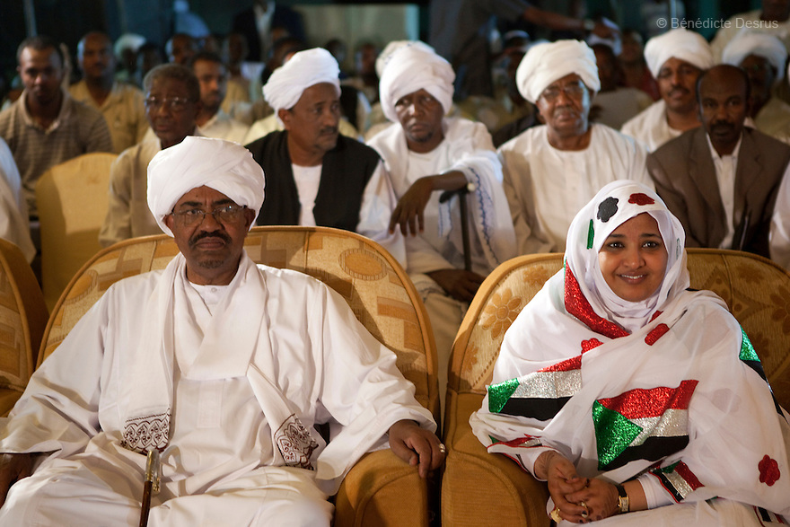 26 april 2010 - NCP party's Khartoum headquarters, Karthoum, Sudan -Sudanese President Omar Al-Bashir and his wife Wadad Babaker attend a celebratory gathering at the NCP party headquarters in Khartoum. He won another term in office, according to election officials, with a comfortable majority in elections marred by boycotts and fraud allegations, becoming the first leader to be elected while facing an international arrest warrant for alleged crimes he orchestrated in the western region of Darfur. The elections take place as Sudan heads toward a referendum in eight months that could lead South Sudan to split off and become Africa's newest nation. Photo credit: Benedicte Desrus