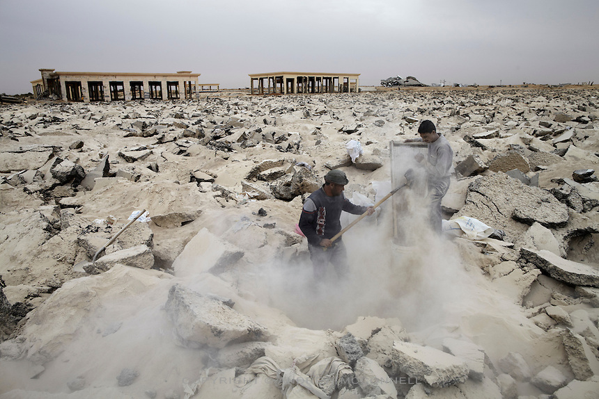 Men remove gravel from underneath the runway at Yasser Arafat International Airport in southern Gaza. Gravel fetches 170 Shekels (approx EUR34) per tonne and is vital for the production of concrete.