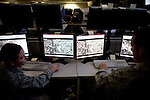 Senior Airman Sara Kennely, left, and Senior Airman Patrick Carrol, right, both intelligence analysts at work on the operations floor at Beale Air Force Base in Linda, Calif., April 7, 2010.