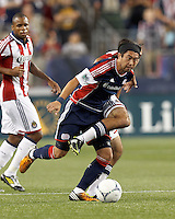 New England Revolution midfielder Lee Nguyen (24) dribbles through trouble. In a Major League Soccer (MLS) match, the New England Revolution tied Chivas USA, 3-3, at Gillette Stadium on August 29, 2012.