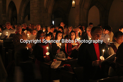 """Rockefeller Chapel held """"A Service of Nine Lessons and Carols for Christmas Eve"""" Tuesday evening. Participants sang Christmas carols during a candle light ceremony."""