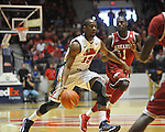 "Ole Miss' LaDarius White (10) vs. Arkansas' Mardracus Wade (1) at the C.M. ""Tad"" Smith Coliseum in Oxford, Miss. on Saturday, January 19, 2013. Mississippi won 76-64. (AP Photo/Oxford Eagle, Bruce Newman)"
