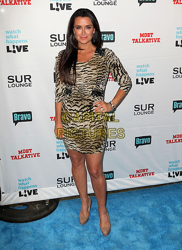 "Kyle Richards.Bravo's Andy Cohen's Book Release Party For ""Most Talkative: Stories From The Front Lines Of Pop Held at SUR Lounge, West Hollywood, California, USA..May 14th, 2012.full length black  dress tiger animal print dress hand on hip beige .CAP/ADM/KB.©Kevan Brooks/AdMedia/Capital Pictures."