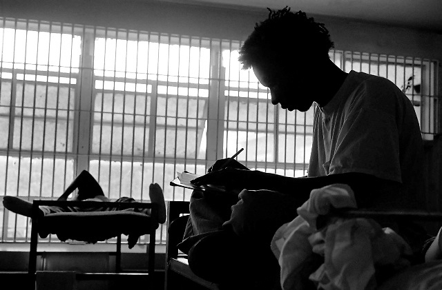 Inmates at Polk Youth Institution sleep or write letters during mandatory lock-down hours, where they aren't allowed to leave their rooms.
