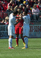 30 March 2013: Los Angeles Galaxy midfielder Landon Donovan #10 is assisted with his captain's arm band by Los Angeles Galaxy defender Todd Dunivant #2 during an MLS game between the LA Galaxy and Toronto FC at BMO Field in Toronto, Ontario Canada..The game ended in a 2-2 draw..