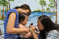 Children's Physicians, Jupiter, Fl. Patient's parent,  release 20120522005, left, her daughter, release 20120522006, Jocelyn Hu, class of 2014.