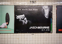 "Advertising for the summer blockbuster hit ""Jason Bourne"" starring Matt Damon in the New York subway on Friday, July 15, 2016. ""Girls"" creator Lena Dunham has advocated defacing the posters for the movie by cutting out the gun.  (© Richard B. Levine)"