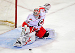 21 December 2008: Carolina Hurricanes' goaltender Cam Ward makes a leg pad save against the Montreal Canadiens in the third period at the Bell Centre in Montreal, Quebec, Canada. The Hurricanes defeated the Canadiens 3-2 in overtime. ***** Editorial Sales Only ***** Mandatory Photo Credit: Ed Wolfstein Photo