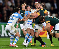 Horacio Agulla of Argentina is tackled by Duane Vermeulen of South Africa. Rugby World Cup Bronze Final between South Africa and Argentina on October 30, 2015 at The Stadium, Queen Elizabeth Olympic Park in London, England. Photo by: Patrick Khachfe / Onside Images