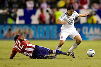 DC United defender Jed Zayner moves past sliding CD Chivas USA defender Dario Delgado. CD Chivas USA beat DC United 1-0 at Home Depot Center stadium in Carson, California on Sunday August 29, 2010.
