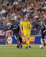 New England Revolution midfielder Shalrie Joseph (21) passes by Columbus Crew midfielder Brian Carroll (16). The New England Revolution tied Columbus Crew, 2-2, at Gillette Stadium on September 25, 2010.