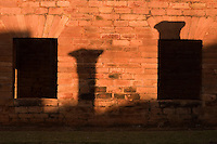 Columns cast shadows on the wall of the main church sanctuary at the ruins if the Jesuit mission church at Jesus de Tavarangue, Paraguay. Scores of Jesuit missions in the area where Paraguay, Argentina and Brazil meet were built in the 17th century and abandoned when the Jesuits were expelled in the 18th century. Ruins of some of these missions still haunt hilltops in the region. (Kevin Moloney for the New York Times)