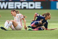 June 23, 2015: Danielle VAN DE DONK of Netherlands and Rumi UTSUGI of Japan clash during a round of 16 match between Japan and Netherlands at the FIFA Women's World Cup Canada 2015 at BC Place Stadium on 23 June 2015 in Vancouver, Canada. Japan won 2-1. Sydney Low/AsteriskImages.com