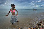 """Miskenda Ridore, a member of Nouvel Etwal - Haitian Kreyol for """"New Stars"""" - dances on the beach at Jacmel, Haiti. Nouvel Etwal is a dance and creative movement group of 16 girls from age 8 to 13, based in the southern village of Mizak. According to Valerie Mossman-Celestin, an organizer of the group, """"Nouvel Etwal seeks to empowers girls to be self-confident and creative. The girls learn flexibility, discipline and teamwork, lessons they also need for life. Nouvel Etwal promotes health, well-being and enhanced self-worth. The girls are encouraged to live into a brighter future where girls and women are valued,  educated, and have equal opportunity to achieve their potential."""""""
