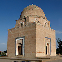 General view of Rukhabad Mausoleum, Samarkand, Uzbekistan, pictured on July 18, 2010, in the afternoon. The Rukhabad Mausoleum (Abode of the Spirit) was built by Timur over the grave of the mystic Sheikh Burhan al-Din Sagarji. The cubic building is topped with a dome based on an octahedron and mausoleum has three entrances. A  19th century carved wooden door leads to the tomb. Samarkand, a city on the Silk Road, founded as Afrosiab in the 7th century BC, is a meeting point for the world's cultures. Its most important development was in the Timurid period, 14th to 15th centuries. Picture by Manuel Cohen.