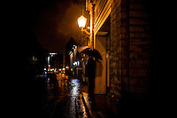 Two men wait in the rain in old section of Tallinn, Estonia in Sept. 2009 outside of a pub. The young democracy joined the European Union in 2004 and since has been working on getting the euro as its national currency. Estonia has one of the highest per capita incomes in central europe.