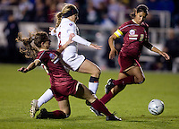 Camille Levin (2) of Stanford has the ball tackled away from her by Alaina Beyar (17) of Boston College during the second game of the NCAA Women's College Cup at WakeMed Soccer Park in Cary, NC.  Stanford defeated Boston College, 2-0.