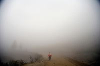 A man walks along a dirt road above rice terraces outside Sheng Cun Village in rural Yuanyang County, Yunnan Province, China.
