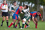 Tim Nanai-Williams fights his way out of the tackle by Risiate Tadulala. Counties Manukau Premier Club Rugby game between Manurewa and Ardmore Marist played at Mountfort Park, Manurewa on Saturday June 19th 2010..Manurewa won the game 27 - 10 after leading 15 - 5 at halftime.