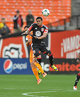 Raphael Augusto (12) of D.C. United heads the ball. The Houston Dynamo defeated D.C. United 4-0, at RFK Stadium, Wednesday May 8 , 2013.