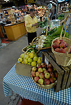 Reading Terminal Market, man buying produce, mod rel..Philadelphia, Pennsylvania, PA USA.  Photo copyright Lee Foster, 510-549-2202, lee@fostertravel.com, www.fostertravel.com.  Photo 230-30522