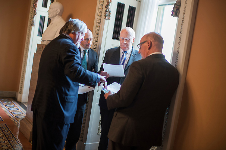 UNITED STATES - JANUARY 31: Sen. Patrick Leahy, D-Vt., talks with staff before the Senate Policy luncheons in the Capitol, January 31, 2017. (Photo By Tom Williams/CQ Roll Call)