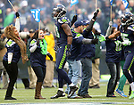Seattle Seahawks cheer the defensive unit as they run onto the field before their game against the St. Louis Rams at CenturyLink Field in Seattle, Washington on  December 30, 2012.    © 2102.  Jim Bryant Photo. All Rights Reserved.