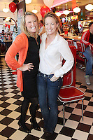 "NO REPRO FEE. 26/5/2011. NEW EDDIE ROCKET'S SHAKE SHOP. Jenny and Kate O Duffy are pictured in the new Eddie Rocket's Shake Shop. The design seeks to recall the vintage milkshake bars from 1950's America and re-imagine them for the 21st century. The new look aims to appeal to both young and old with a quirky and bold colour scheme and a concept of make-your-own milkshakes, based on the tag line ""You make it...We shake it!"". Eddie Rocket's City Diner in the Stillorgan Shopping Centre in south Dublin has re-opened after an exciting re-vamp and the addition of a Shake Shop. Ten new jobs have been created with the Diner's re-launch bringing the total working in Eddie Rocket's Stillorgan to 30. Picture James Horan/Collins Photos"