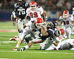 Ole Miss running back Brandon Bolden (34) is tackled by Fresno State's Derron Smith (13)  and Fresno State's Davon Dunn (2) and Fresno State linebacker Travis Brown (9) during the fourth quarter at Vaught-Hemingway Stadium in Oxford, Miss. on Saturday, September 25, 2010. Ole Miss won 55-38.