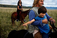 "Rowan, a five-year-old autistic child, riding a horse, accompanied by his parents, Kristin Neff and Rupert Issacson, during a horseback expedition across Mongolia. Rowan, who has been nicknamed ""The Horse Boy"", embarked on a therapeutic journey of discovery with his parents to visit a succession of shaman healers in one of the most remote regions in the world. Following Rowan's positive response to a neighbour's horse, Betsy, and some reaction to treatment by healers, Rowan's parents hoped that the Mongolian shamanistic rituals along the route and the prolonged contact with horses would help to unlock their son's autism and assist his development.."