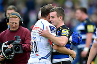 George Ford of Bath Rugby hugs former Leicester Tigers team-mate Julian Salvi of Exeter Chiefs after the match. Aviva Premiership match, between Bath Rugby and Exeter Chiefs on October 17, 2015 at the Recreation Ground in Bath, England. Photo by: Patrick Khachfe / Onside Images