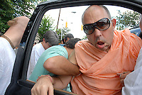 His Holiness Jayapataka Swami Maharaj is helped out of his car during the Ratha yatra proccesion on Moreland Avenue in Atlanta's Little Five Points community.  Atlanta's Hare Krishnas celebrated Rathayatra and Panihati Festival with dance, live music, traditional vegetarian fare and chanting in the streets of Little Five Points. His Holiness suffered a stroke in October 2008.