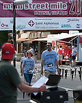 Kay & Kirk Harwood cross the finish in the Mayor's Mile during Main Street Mile run in downtown Boise, Idaho on June 22, 2012.