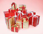 Pile of Christmas gift boxes isolated on pink background with clipping path