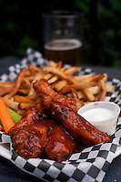 Summer evening: chicken wings, french fries, and beer.